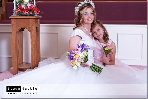 Bride and daughter share a pose after the wedding - photography by Steve Jackle Photography.