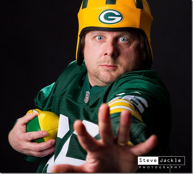 NFL Green Bay Packer fan stiff arm by Raleigh event and portrait photographer Steve Jackle